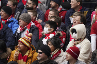 Fans wearing face masks attend a Liverpool match in the English Premier League.