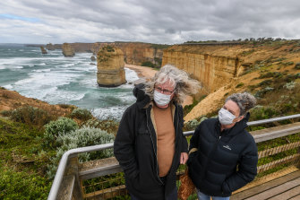 Tourists at the Twelve Apostles, one of the state's major attractions.