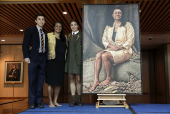 Senator Nova Peris with children Jack  and Destiny and her portrait at Parliament House in Canberra on  Wednesday.