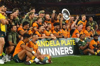 The Wallabies celebrate their Mandela Plate victory.