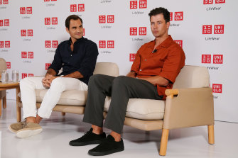 Adam Scott, right, with Roger Federer, left, at a press conference in Melbourne on Monday.