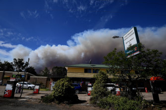 Smoke from the Gospers Mountain fire near Colo Heights, north-west of Sydney, was streaming across parts of the city on Friday afternoon.