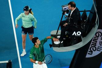 Novak Djokovic taps the chair umpire's foot during the Australian Open final.