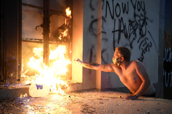 A protester starts a fire at the Metro Courthouse in Nashville, on Saturday.