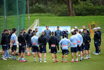 Sydney FC players and coaching staff assemble ahead of their first training session after the Covid-19 shutdown at Macquarie University on Wednesday.