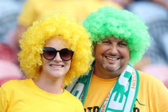 A couple of punters at Newcastle getting ready for the big game. Presumably that is not their real hair.