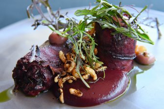 Roasted beetroot with black rice, purple mustard and dill.