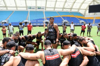 Latrell Mitchell and his Indigenous All Stars teammates practice the war cry they will perform before the All Stars clash on Saturday night.
