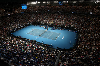 Fans watch Roger Federer and John Millman in action on Rod Laver Arena at this year's Australian Open. All tournaments during the forthcoming Australian summer could yet be played in Melbourne due to the coronavirus.