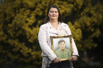 Jenni Rickard, of the Australian Parents Council, with a photo of her soldier grandfather.