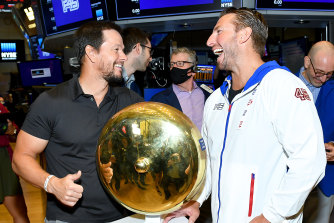 Mark Wahlberg (L) and F45 founder and CEO Adam Gilchrist at the New York Stock Exchange in July.