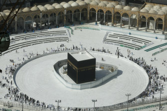 Few worshippers were allowed to enter after dawn prayers to circumambulate the Kaaba in the Grand Mosque over fears of coronavirus.