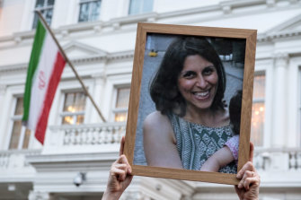Supporters hold a photo of British-Iranian mother Nazanin Zaghari-Ratcliffe, whose jail sentence was recently extended by a year.