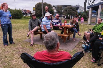 Hallam dive shop owner Corry Allen (green top), from Dive Gear Australia, at Rye beach with friends.