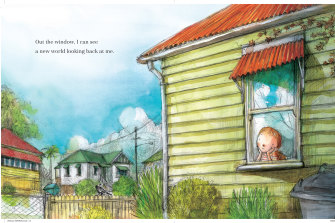 Window to the world: a child gazes out from a house in the book 'Windows'.
