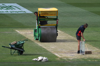 """Average"": Groundsmen roll the pitch on day two of last year's Boxing Day Test at the MCG."