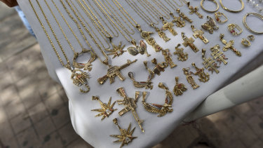 A man sells jewellery using narco-culture imagery in downtown Culiacan, in Mexico's Sinaloa state.