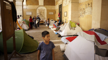 Homeless Italians and migrants camp under the portico of the Roman Catholic Basilica of the Twelve Holy Apostles in downtown Rome in 2017.