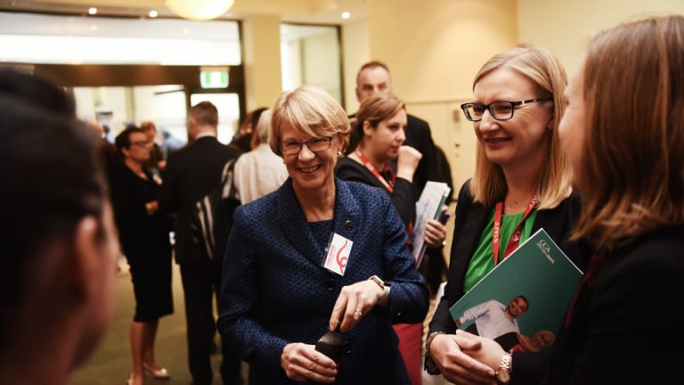 Coca-Cola Amatil chief executive Alison Watkins (left) mixing with shareholders after Wednesday's AGM.
