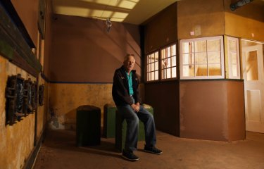 Volunteer guide Barry McDonald in the almost renovated former plotting rooms for the North Head artillery.