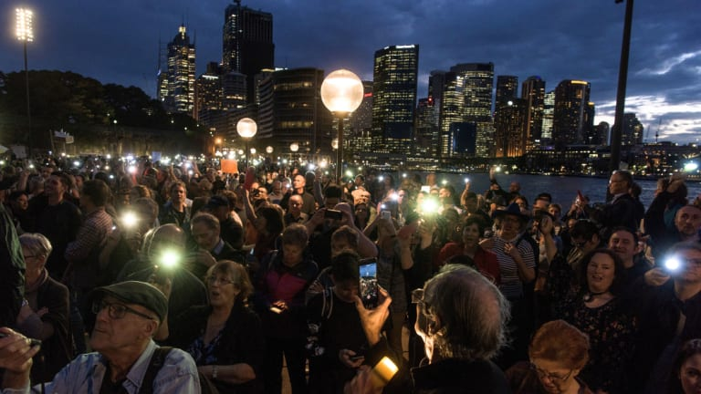 At least 1000 people turned up to the harbour foreshore on Tuesday night, protesting against a projection promoting The Everest horse race on the Opera House.