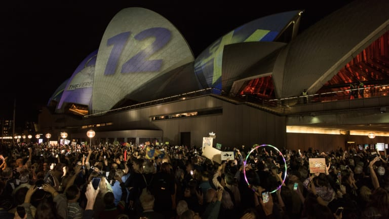 Protesters opposing the projection of material promoting The Everest horse race onto the sails of the Opera House.