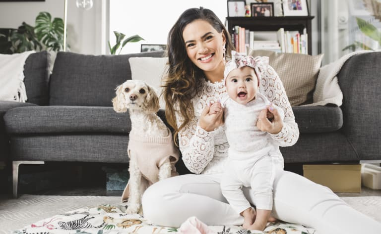 Janette Wojtaszak, with baby Luna and puppy Cookie, is the face of the SurfaceGo's national campaign.