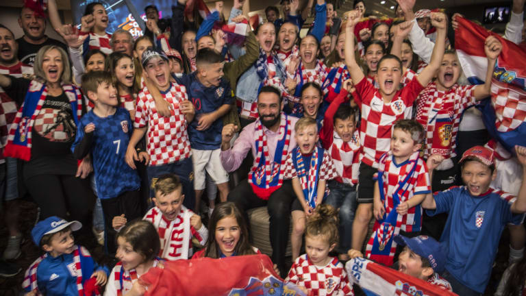 General Manager Roye Estephan, centre, with pumped Croatian football fans at Sydney's King Tom Club.