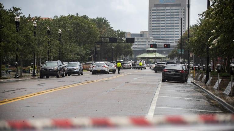 Police barricade a street near Jacksonville Landing in Jacksonville, Florida.