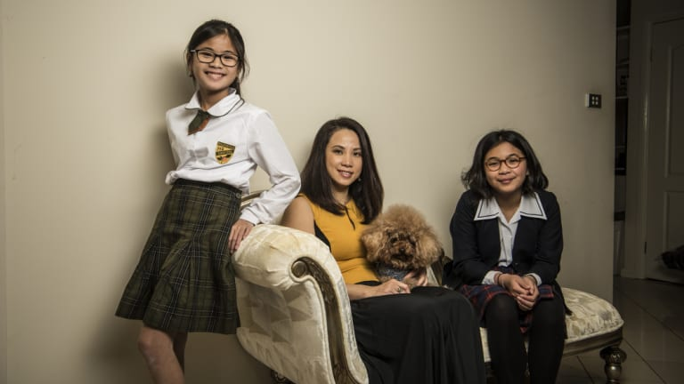 """The standard is higher"": Yuliana Hartanto with her two daughters, Sienna, 12, and Felicia, 15."