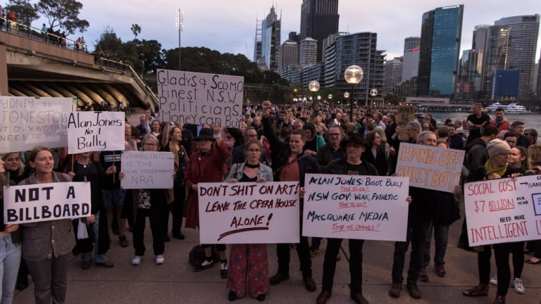 Protesters assembled on the harbour foreshore opposed to the projections of promotional material for the Everest Horse Race.