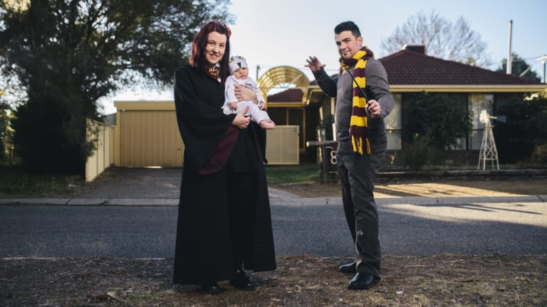 Andrew and Bec Grayson and baby girl Aurora at home in their Harry Potter cosplay outfits.