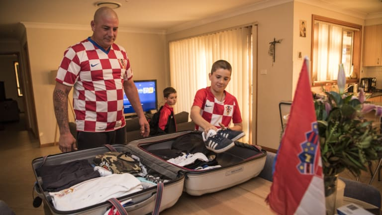 Call of duty: Tragic Croatia fans Robert Bobanovic and his son Karlo from Sydney's Kemps Creek pack their bags for Zagreb to watch the football World Cup final.