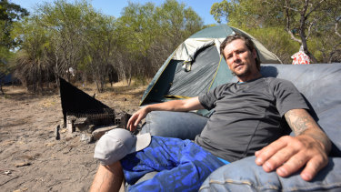 Tristan sits outside of his tent at the Rockingham shanty town, a makeshift camp home to 17 people.