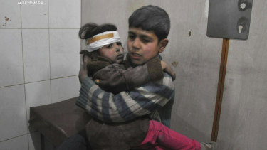 Children are treated in hospital after homes in Ghouta were bombed by government forces.