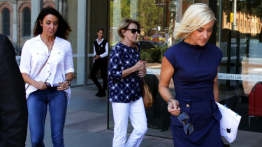 Sarah Walker (right) leaving court on Wednesday, trailed by her sister Kate Hertogs and their mother Jennifer.
