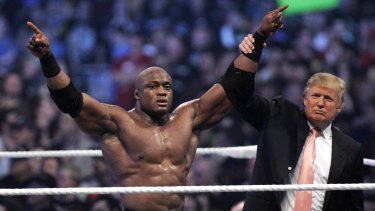 Donald Trump raises the arm of wrestler Bobby Lashley after he defeated Umaga at WWE's Wrestlemania 23 in 2007.