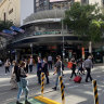 10 new Qld cases linked to Indooroopilly, Premier flags harder border