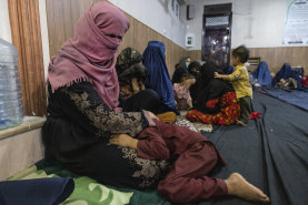 Displaced Afghan women and children shelter in a mosque in Kabul on August 13.