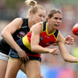 Breann Moody tackles Chelsea Randall of the Crows during the 2019 AFLW Grand Final match between the Adelaide Crows and the Carlton Blues.