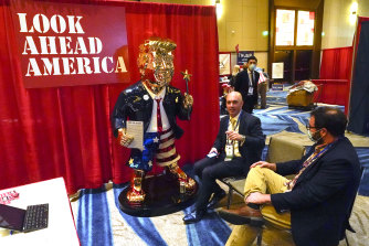 Matt Braynard, centre, talks to Conservative Political Action Conference attendees at his booth at the event in Florida in 2021.