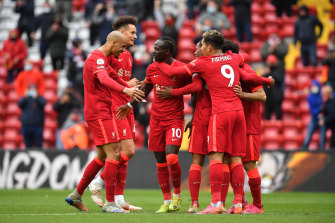 Sadio Mane celebrates with his Liverpool teammates after scoring against Crystal Palace.