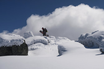 A snowboarder ascending Mount Tate in the Snowy Mountains.