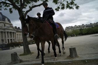 Mounted Police patrol on the Champ de Mars in Paris during the national coronavirus lockdown.