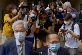 Pro-democracy lawmaker Martin Lee, left, and Albert Ho arrive at a court in Hong Kong on Thursday, April 1, 2021.