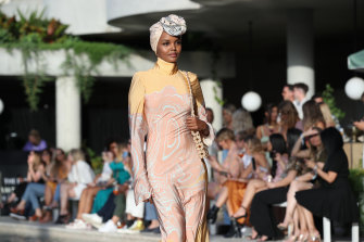 Modest chic ... Halima Aden walking in The Iconic's summer show.