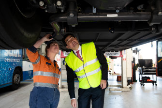 Volvo Bus apprentice, Renee Gibson with Tertiary Education Minister, Geoff Lee who has announced new skills training for mechanics working on electric vehicles.
