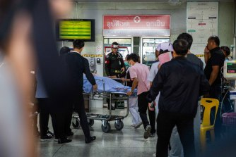 Victims of the Terminal 21 mall shooting are treated at Maharat Nakhon Ratchasima Hospital on Sunday.