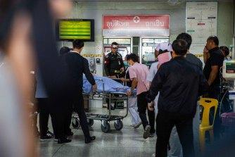 Victims of the Terminal 21 mall shooting are treated at Maharat Nakhon Ratchasima Hospital on Sunday.