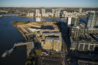 Suburbs on the banks of the Parramatta such as Wentworth Point, in the foreground, have grown rapidly in recent years.